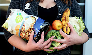 The Guardian's reluctant dieter holding healthy food