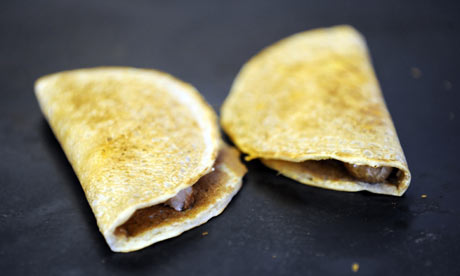 Filled oatcakes on a griddle