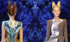 Models present creations by British designer Alexander McQueen
