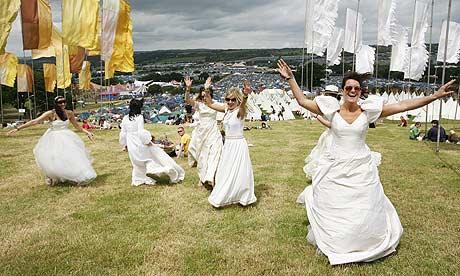 Women in wedding dresses at Glastonbury festival