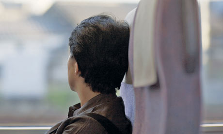 Woman on a train, looking out of the window