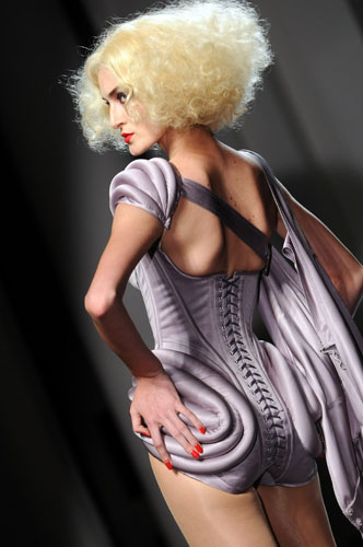 The whole colection harked back to a bygone age of glamour  :  glamour fashion week haute couture bustier