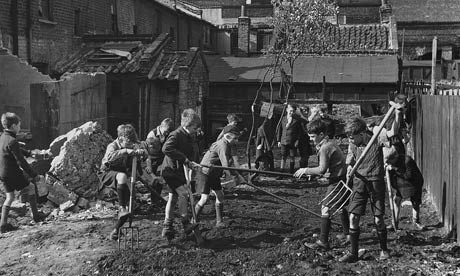 Boys create an allotment on a bomb site in the East End of London