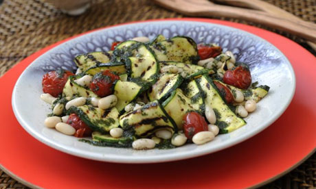 Grilled courgette, tomato and bean salad dressed with basil
