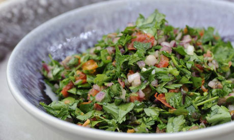 A bowl of parsley salad, try piled on crostini