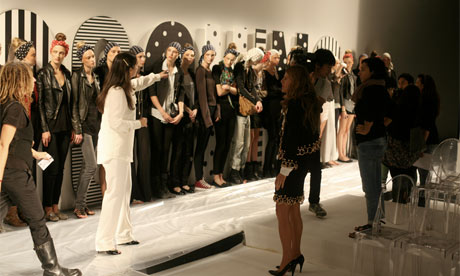 Anna Della Russo directing the Moschino runthrough at Milan fashion week
