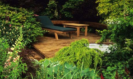 Designing small gardens the delights of decking life for Garden design decking areas