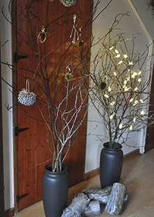 Vases full of spray-painted branches