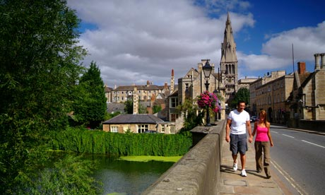 Couple crossing a bridge over the River Welland in Stamford, Lincolnshire.