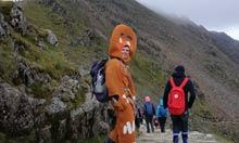 A fell runner dressed as a gingerbread man