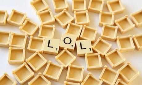 Scrabble tiles spelling out LOL
