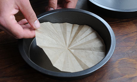 Dan step 1: Line the base of two ungreased deep round cake tins with discs of nonstick paper.