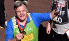 Ed Balls celebrates after completing the 2014 London Marathon