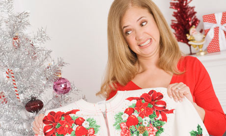 unhappy woman with Christmas jumper under tree