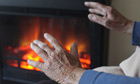 woman's hands in front of fire