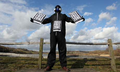 A masked man protesting about fracking near Ardingly Reservoir, West Sussex, UK.