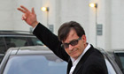 Charlie Sheen gestures to the camera