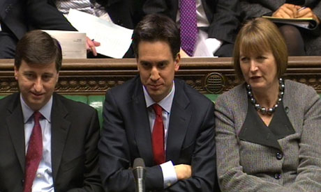 Ed Miliband listens to prime minister David Cameron
