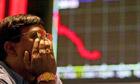 A Kuala Lumpur investor watches stock market slump