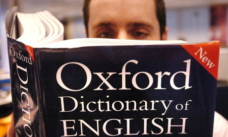 Man reading dictionary