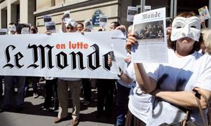 Le Monde strikers