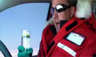 Jeremy Clarkson drinking a gin and tonic at the wheel in the Top Gear Polar Special