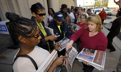 Newspaper buyers in Detroit after Barack Obama victory