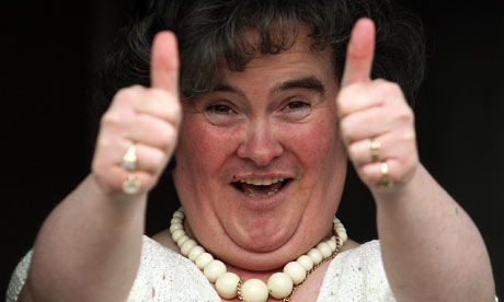 Susan Boyle gives thumbs-up outside her house
