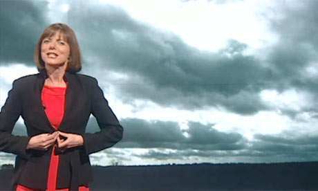 BBC weather presenter Louise Lear buttons up her jacket as she begins her