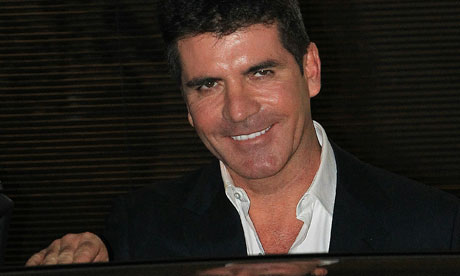 simon cowell wife 2010. simon cowell trousers.