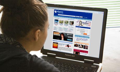 Teenage girl looking at MySpace