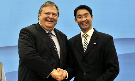 Evangelos Venizelos shaking hands with Philipp Rsler