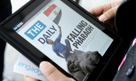 A journalist views the Daily on an iPad