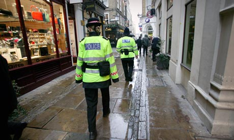 Police officers are to be told they will have to accept a cut in take-home pay in return for fewer job cuts. Photograph
