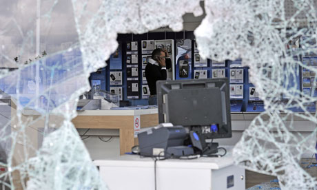 London riots: a looted O2 mobile phone store in Tottenham Hale retail park.