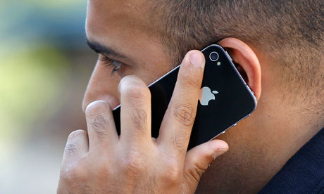 A man uses an Apple iPhone