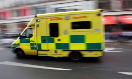 An ambulance passes at high speed