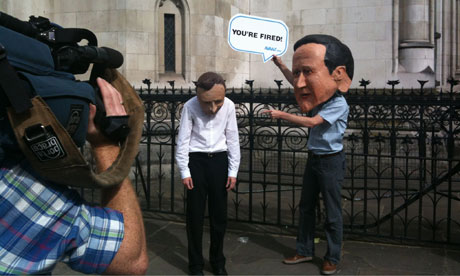 Leveson inquiry: protesters wearing Hunt and Cameron masks