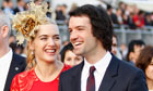 File photo of British actress Winslet and her then boyfriend Rocknroll in Hong Kong
