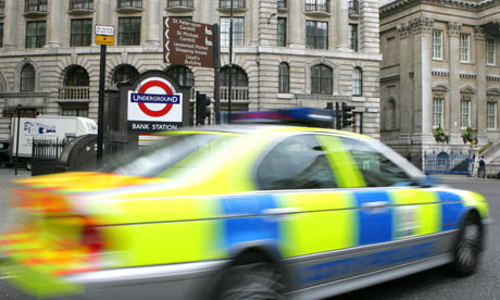 A police car drives past Bank underground station