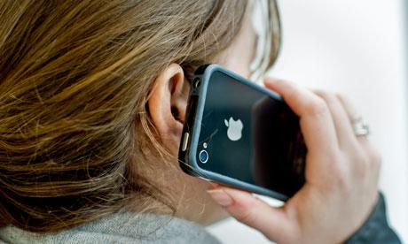 Woman using an Apple iPhone smartphone