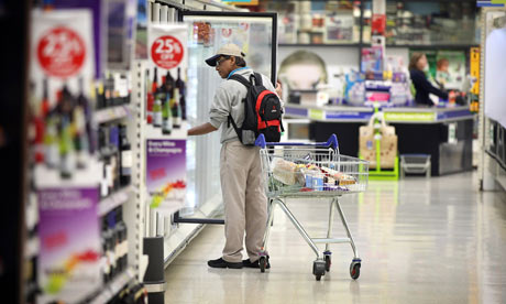 A customer browses for products at a Tesco supermarket in London