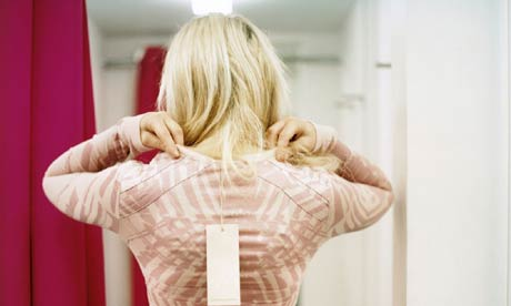 Trying clothes on in a changing room