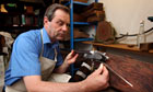 Paul West at work in William and Son gunsmiths, 14 Mount Street, Mayfair, London