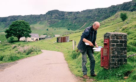 A postman delivers the mail on the Isle Of Eigg