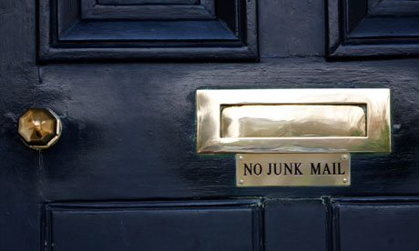 A letterbox with a 'no junk mail' sign by: Martin Argles for the Guardian