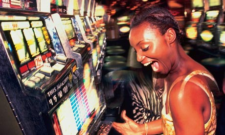 A woman playing a slot machine in a casino