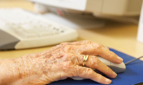 Older person's hand on a computer mouse