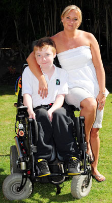 EasyJet's 'discriminatory' wheelchair policy grounds mother Alexandra Spencer and her son Declan