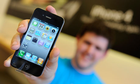 A man holding an iPhone 4 up to the camera